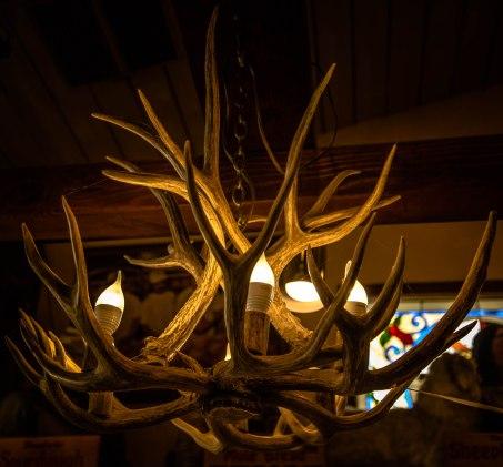 A chandelier made from deer's antlers, one of many hanging in Schatt's Bakkery in Bishop, CA.