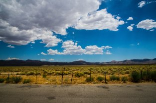 The view of distant mountains and clouds, as seen from the Coso Junction Rest Area.